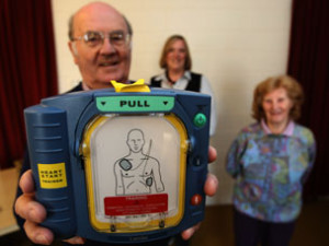 Brian Lay, Pauline Stratful and Pat White with the Halls defibrillator