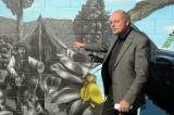 John Riddell points out the gum diggers on the mural at the launch of Paint NZ Beautiful